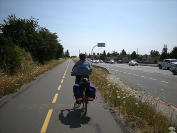 riding along the Lochside Trail, Trans Canada Highway on the right